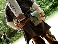 Custom quiver: wood bottom, leather construction, chest/waist harness for stability