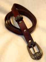 Brown belt with brass hardware