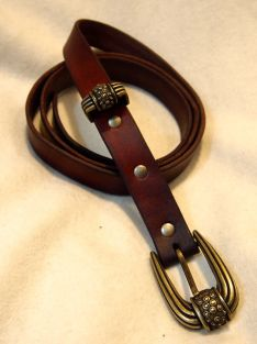 Brown belt with brass hardware